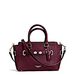 Coach mini burgundy carryall bag