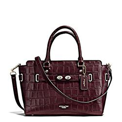 Coach embossed oxblood carryall