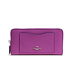 Purse in purple by Coach at Wertheim Village