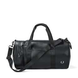 Travel bag in black by Fred Perry at Wertheim Village