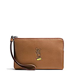 Clutch 'Mickey Leather Corner Zip' in saddle by Coach at Ingolstadt Village