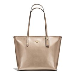 Women's handbag in gold by Coach at Ingolstadt Village