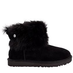 Women's boots in black by UGG at Wertheim Village