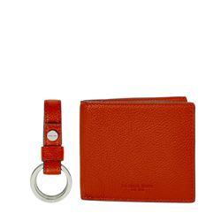 Wallet and key chain in orange by Michael Kors at Ingolstadt Village