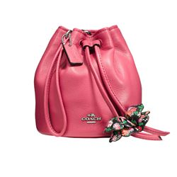 'Petal Wristlet' in  Rosa von Coach in Wertheim Village