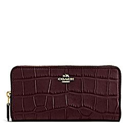 Coach oxblood zip clutch