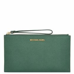 Clutch 'Jet set travel' in dark green by Michael Kors at Wertheim Village