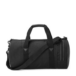 Cloth travel bag in black by Fred Perry at Wertheim Village
