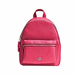 coach backpack purse outlet l8hf  Mini Charlie backpack in bright pink