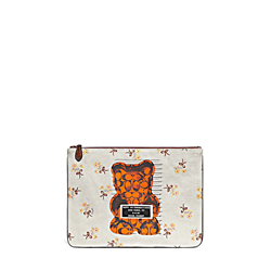 'Gummy Bear Canvas Wrislet 30' Clutch in White with flowers by Coach in Ingolstadt Village